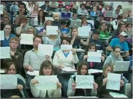 photo of the students holding up their signs