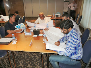 Qatari engineers work in a group to solve practical engineering problem