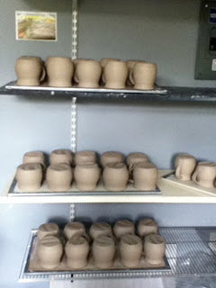 Drying ceramic pieces by Lori Buff