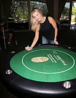 Joanna Krupa sinning a poker table