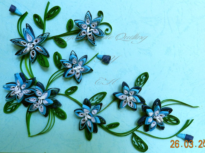 A journey into quilling paper crafting quilled flowers cascade in i have never used blue so i made these quilled 3d flowers from dark blue light blue and white strips just made up the design as i went along mightylinksfo