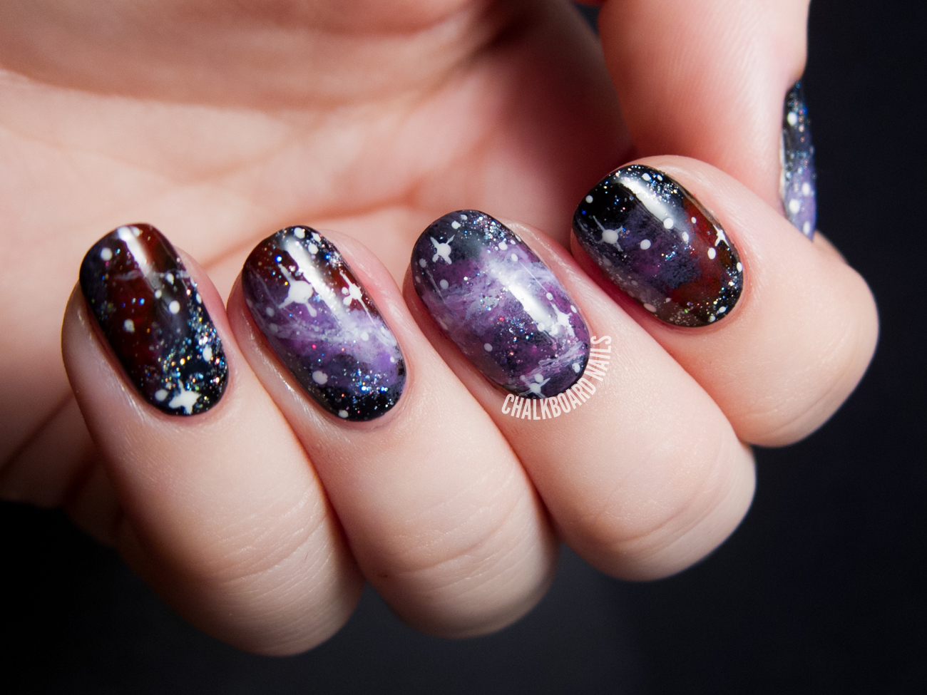 Galaxy nail art by @chalkboardnails