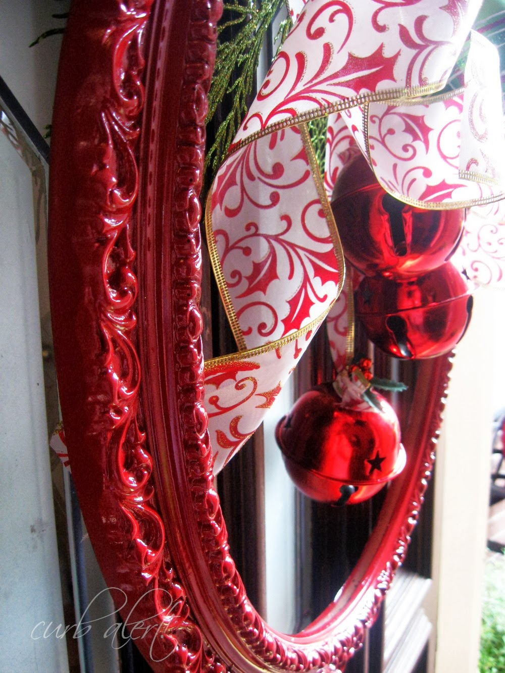 Red Framed Holiday Wreath with Dollar Store Supplies via curb alert!