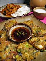 Korean seafood pajeon with kimchi, tofu and makgeolli
