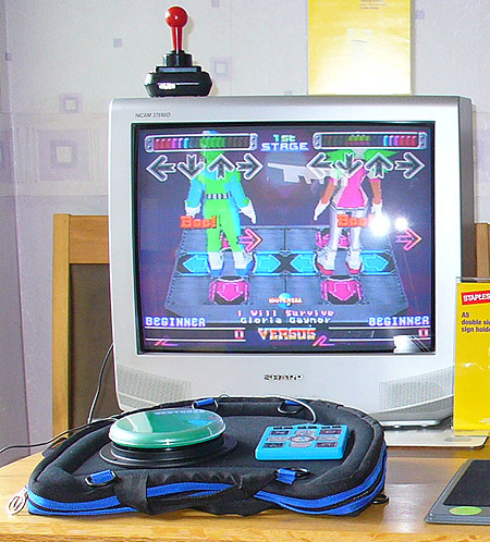 One-switch Dance Dance Revolution dance mat game, made more accessible.