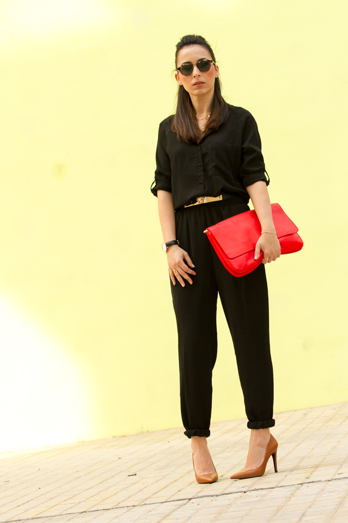 Black jumpsuit with tanned stilettos and red clutch styled by fashion blogger withorwithoutshoes