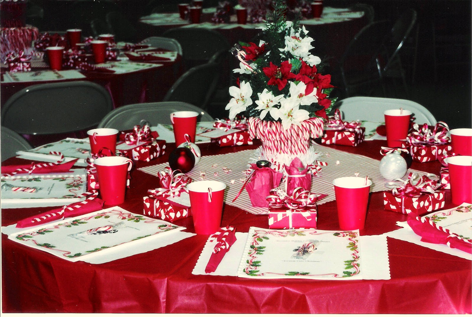 i purchased red stripped pillow ticking fabric from calico corners for the center of the tables to visually help carry out the candy cane theme