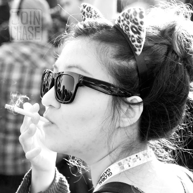 A Korean woman puffs her cigarette at Global Gathering 2011 in Seoul, South Korea.
