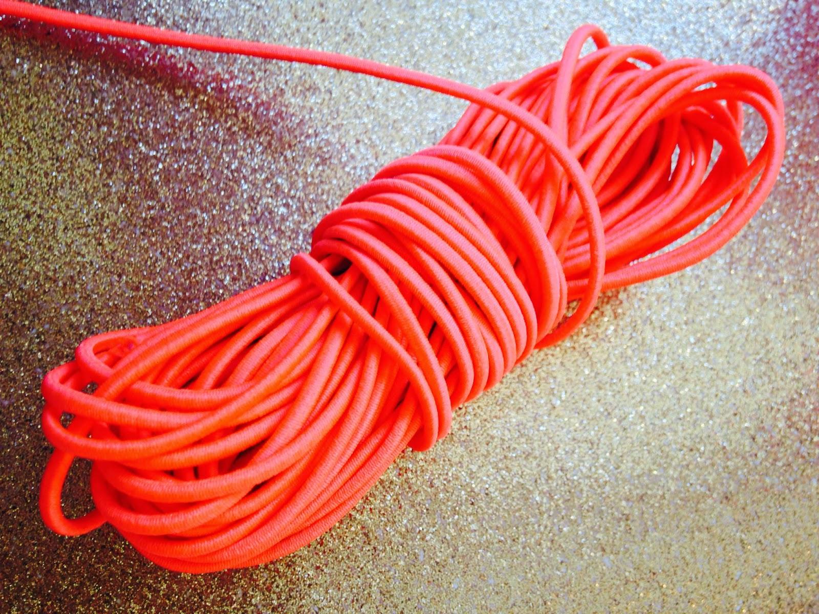 Elastikbånd i neonfarvet koral - 2mm i diameter.