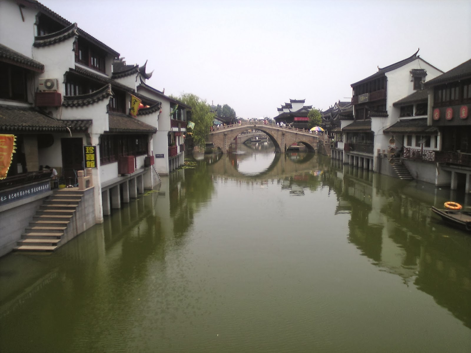 qibao ancient town qibao map seven treasures old town is area with buildings done in the old style selling lots of local food and snacks