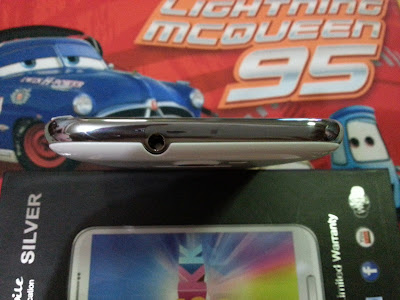 SKK Mobile Silver 3.5mm audio jack at the top