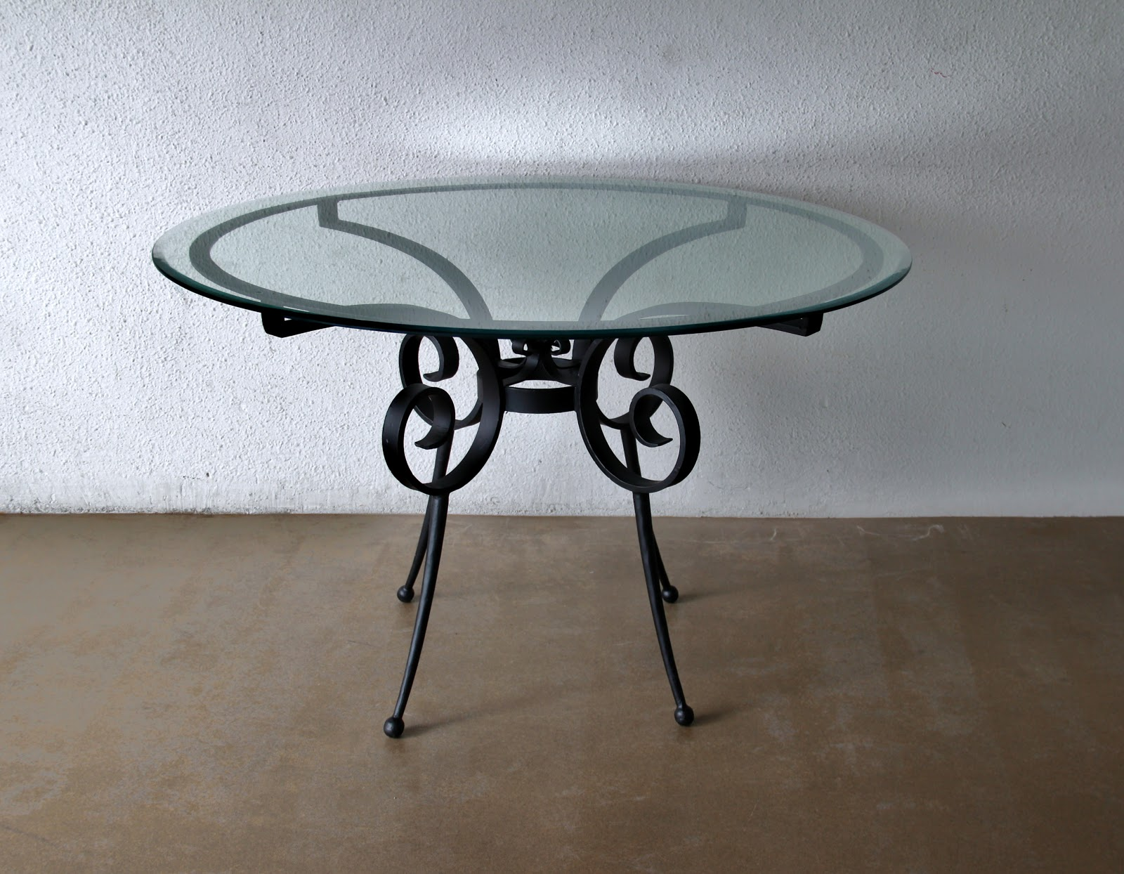 Discerning for designs the dominating influence of for Cast iron and glass dining table