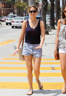 Jennifer Lawrence in denim shorts and a blue tank crossing