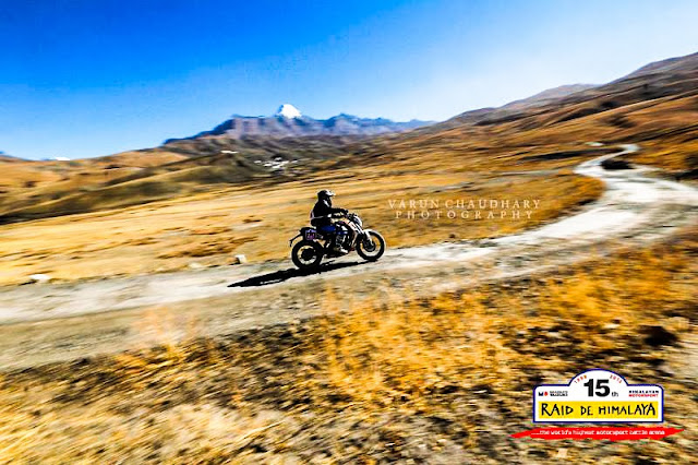 Varun Chaudhary has been sharing some of the great Motorsport Photo Journeys with us for last few years and this time it's about recent chapter of Raid de Himalaya 2013. It was 15th Raid-de-Himalaya event by Himalayan Motorsports which started from Shimla and goes towards Leh through one of the most difficult terrains in Himalayas. Let's check out this Photo Journey and know about the action during these couple of days on roads...So this time Raid-de-Himalaya happened from 4th October to 12th October.  On 4th & 5th  October 2013, administrative and Technical Scrutiny happened ensure safety norms are adhered to as per the FiA, FIM and Federation regulations. All this happened in Shimla and other hills around it. A Ceremonial Start happened in the afternoon of the 5th October 2013, along with drivers briefing and the press meet. Raj Singh Rathore had come with polaris and many of the contestants had eyes on Raj for a winning position this time, but unfortunately he had to quit because of technical failure on the way.On 6th October  2013, riders started from Shima and day's halt was Manali. On first day there was 3 stages to Manali. Short, fast, yet testing enough .. And day1 is most challenging for folks participating first time. And many of the folks get out of the race on day 1 itself. There can be multiple reason for getting out of the race.. Technical breakdown is one of them..Second day started with ride from Manali | 7th October  2013 Halt for the day was Kaza. It was a beautiful run over the first pass of the Pir Panjal range - Rohtang. Day 2 had one of the iconic stage from Gramphoo to Losar . This time it was rougher than ever. Just this one stage for the day saw the rally get into Kaza... And then it was time to repair and get ready to continue the next journey.On 8th October  2013, the journey started from Kaza and plan was to come back to Kaza via Dhankar... It was day of exploring The Monastery Necklace with dirty motors roaring around the hills.. It was a day filled with climbs and descents with awesome landscapes as the route winds by one monastery, then another and yet another... Stages of third day were tight, weather was unpredictable and tough competition of-course :)On 9th October  2013, again all riders and the convoy started from Kaza to ride through Gramphoo, Patseo and Sarchu to hit Pang. The 4th day of the rally promised to be a long one. Terrible stage back to Gramphoo and then the superfast one from Patseo to Sarchu promised high altitude action beyond compare! At Pang, the team stayed at Army barak. Pang was relatively in pain regions but was chilled out there.On 10th October  2013, all of us started from Pang towards Leh through Debring... The day was extremely fast paced. Two stages that were both fast and tricky tested the nerves & skill .. The Himalayas watched overOn 11th October 2013, it was again a tour back to Leh via Wari La... Comparatively a short day. Definitely not an easy one though. A single stage - all tarmac - but extremely technical. Most were  trying to hold it all together till the finish line... During the final stage Sanjay Aggarwal made best use of his skills and Grand Vitara to take second place. The last day - 12th October 2013- It was Prize Distribution Ceremony  which concluded by 1300 hrs, followed by lunch.During the Raid-de-Himalayan event, security is one of the main concern and team ensures that everyone is hit along with their motors & backup plan. Apart from that rescue teams are appointed at different posts on the way and there was a chopper for emergency cases. Fortunately we didn't need it during the event and everyone was happy about the fact.Helly holds the overall first position of Raid-de-Himalaya 2013 ! A very fast dude from Austria. And it was his birthday on prize distribution day.Here is a nice account on the ride of first day - ttp://www.motoroids.com/news/maruti-suzuki-raid-de-himalaya-2013-day-1-results/Raid-de-Himalaya is one of the most popular Motorsports events in India and riders starts waiting for next event from the day the previous one ends !!!