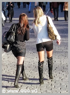 Girls in black high heels boots on the street