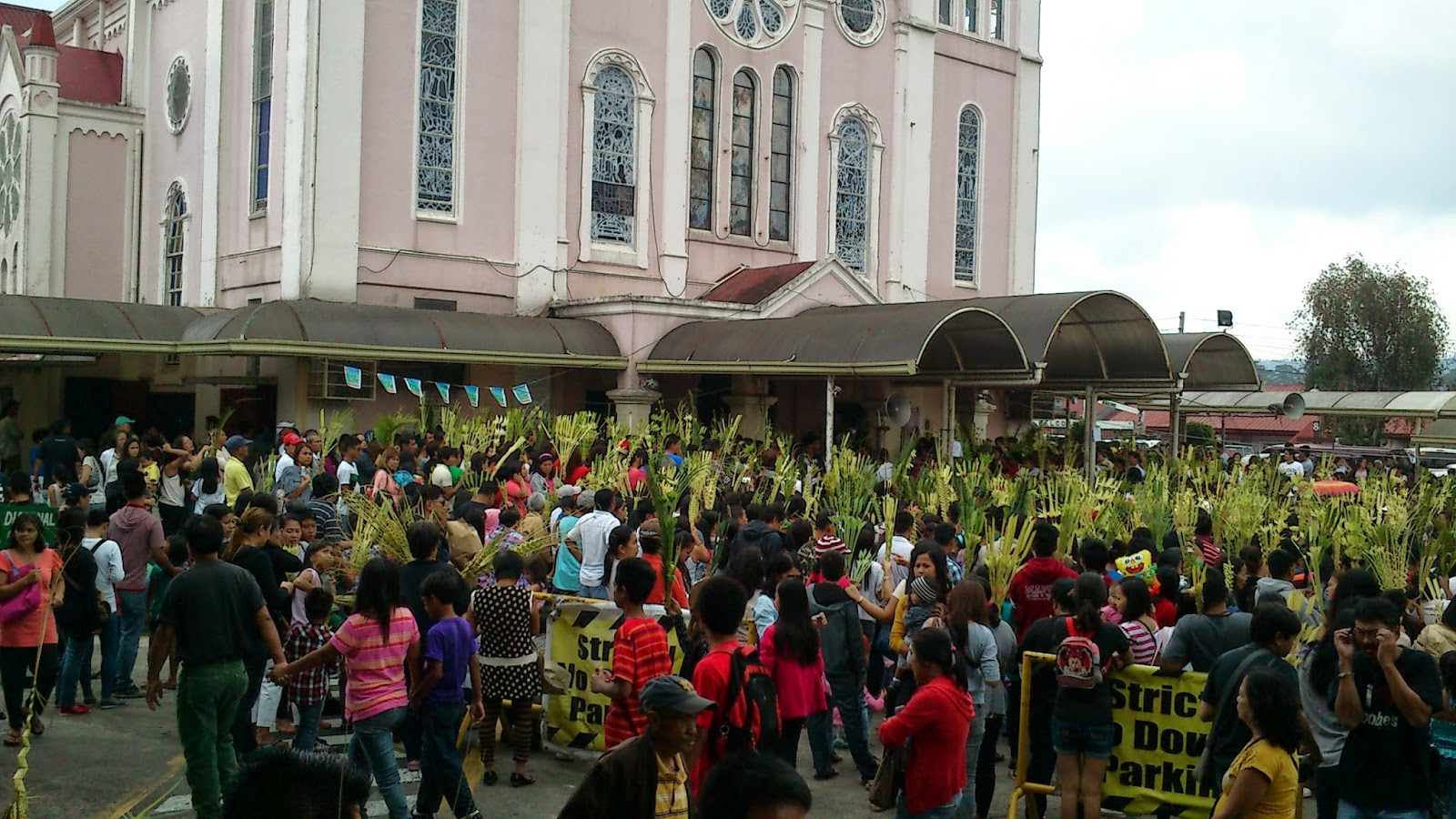 People waiting for the Palm blessing outside Baguio Cathedral.