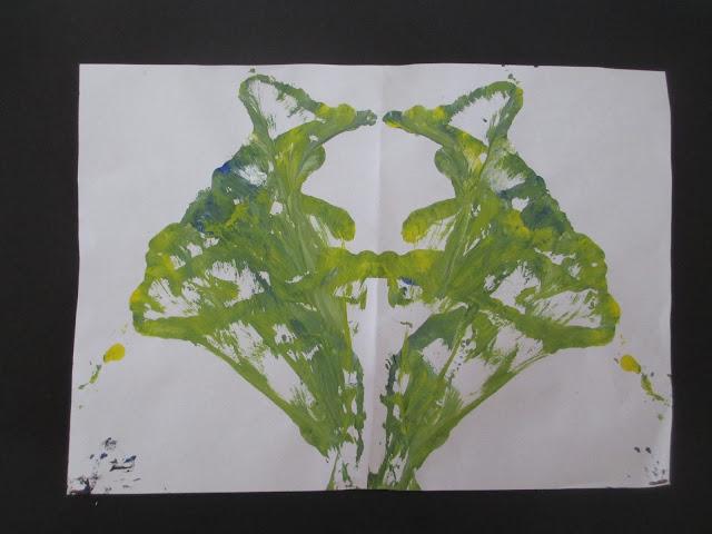 zeichnen mit farbigem Wollfaden