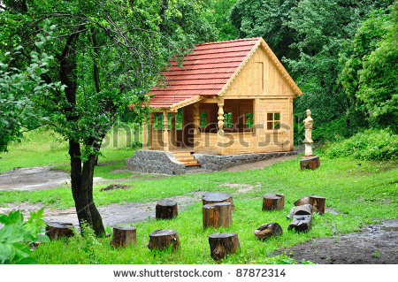beautiful small houses with lots of green trees plants and flowers