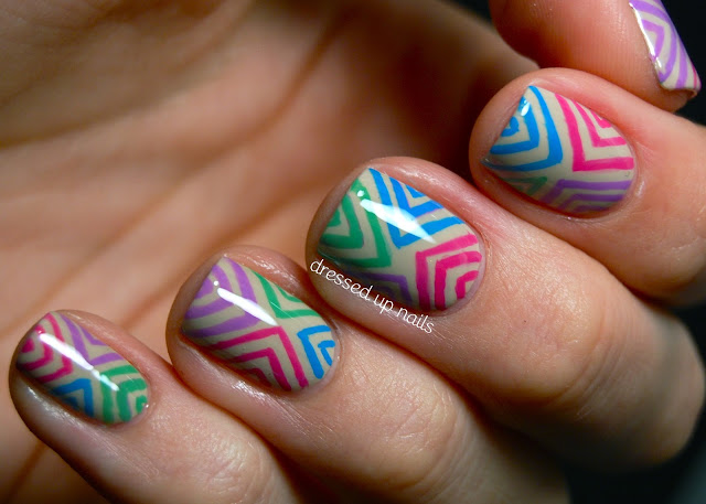 Colorful offset chevron nail art on Revlon - Bare Bones