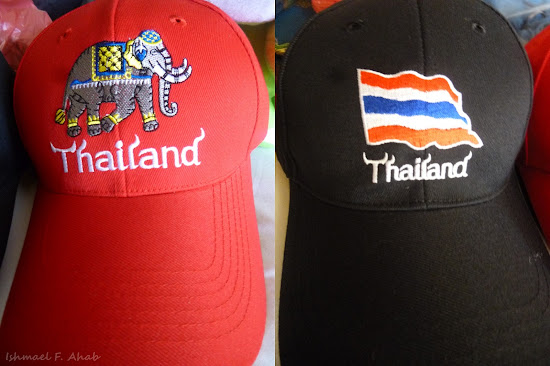 Souvenirs from Mahboonkrong: baseball caps