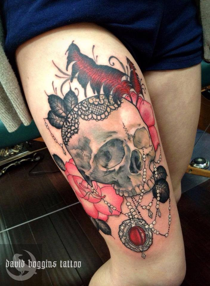 Skull with jewelry and pink roses tattoo on thigh by David Boggins