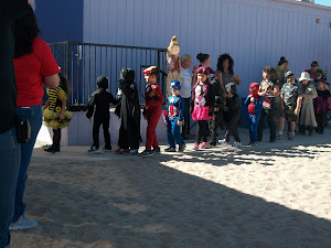 Logan as Capt. America at school Halloween parade (in blue in center)