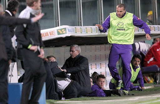 Fiorentina coach Delio Rossi is seen fighting with one of his own players Adem Ljajić