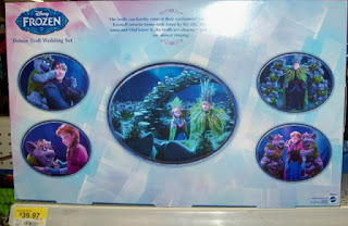 Box back of Disney Frozen Troll Wedding Set showing scenes from the movie