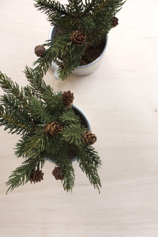 Pine branches (fake or real) inside tin mugs. Mini tabletop Christmas tree diy by Hello Lidy
