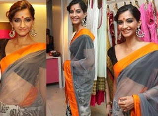 hot sonam in hot saree with hairstyle
