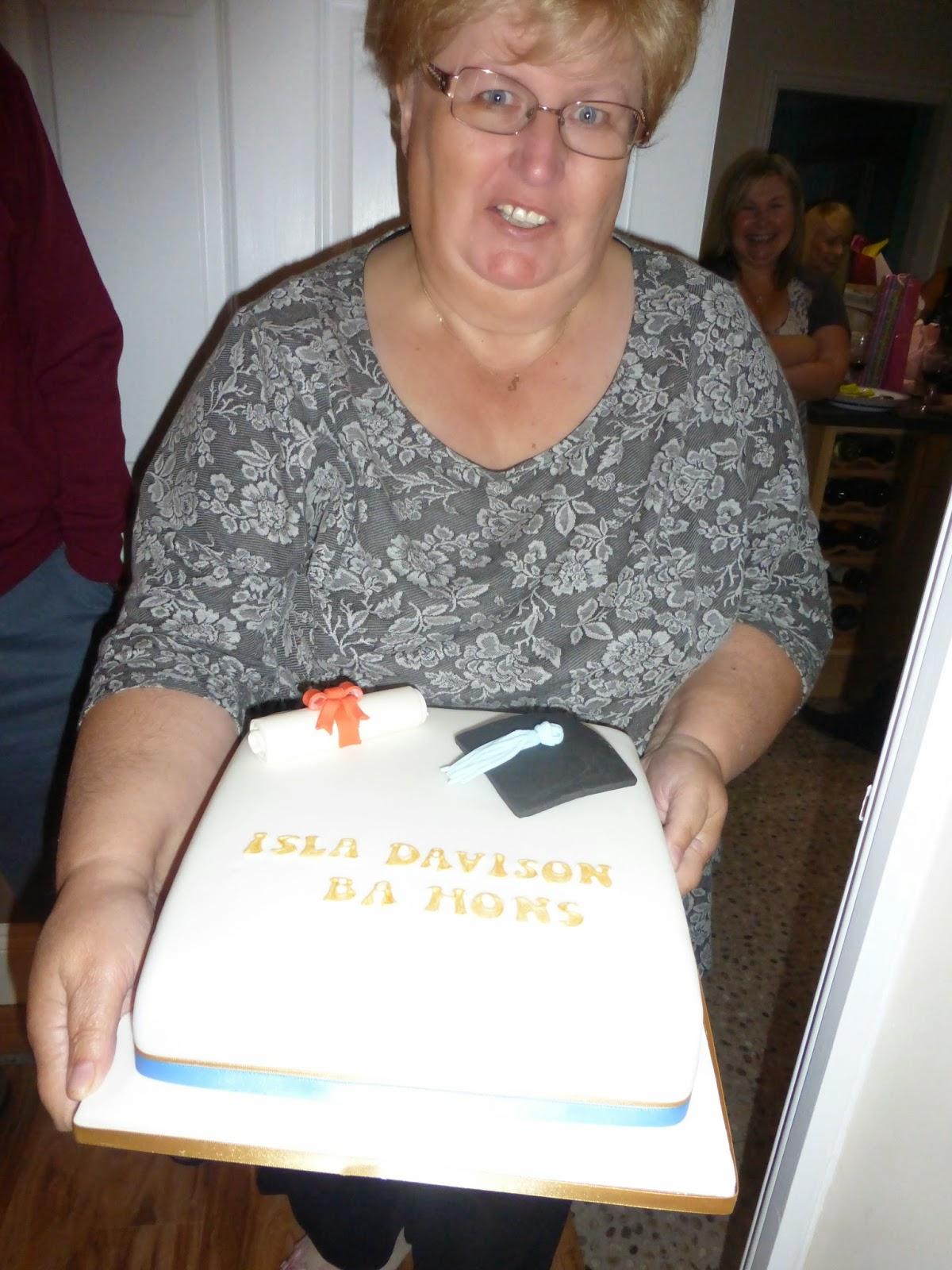 my mum with my graduation cake