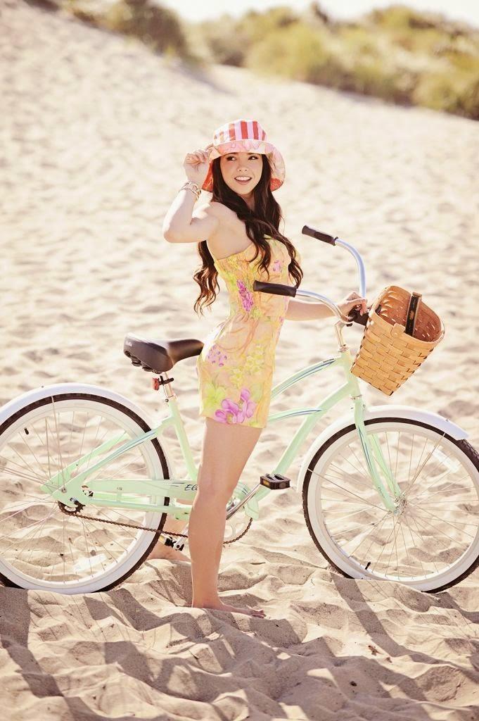 Hot beautiful asian girls on bicycle