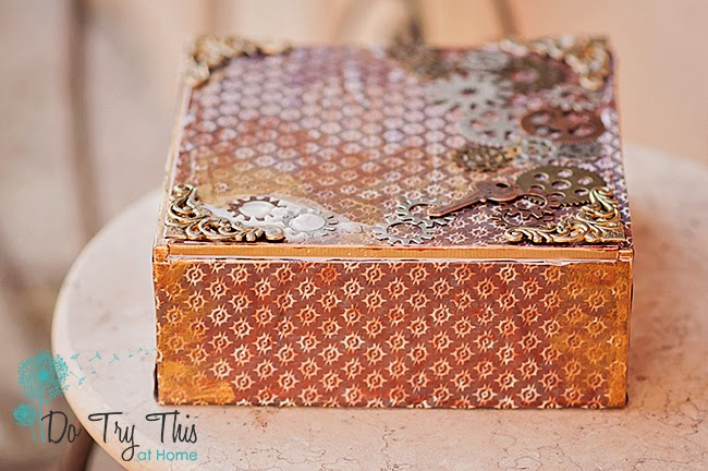 Altered cigar box with embellishments