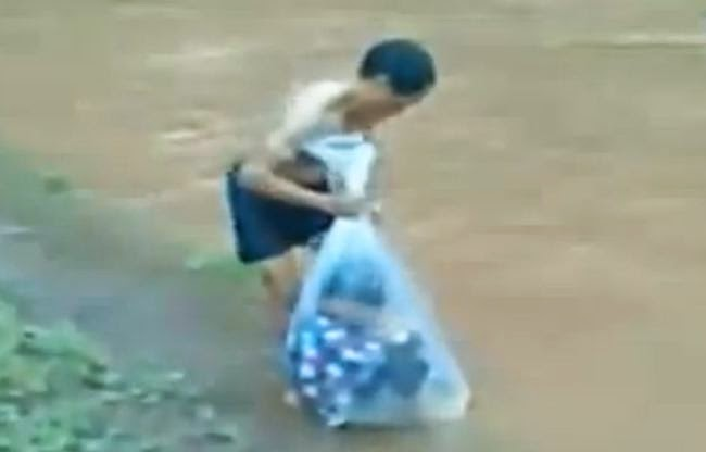 Children travel to school wrapped in plastic bags