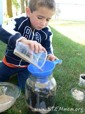 Boy pouring sand into Worm jar: STEMmom.org