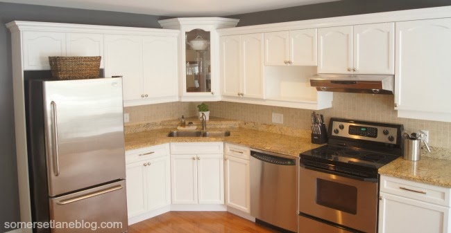 spray painted dark cabinets into white cabinets