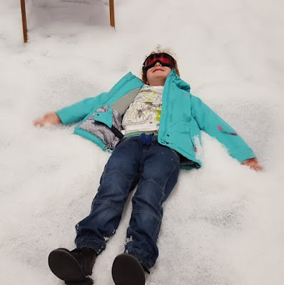 Playing in artificial snow