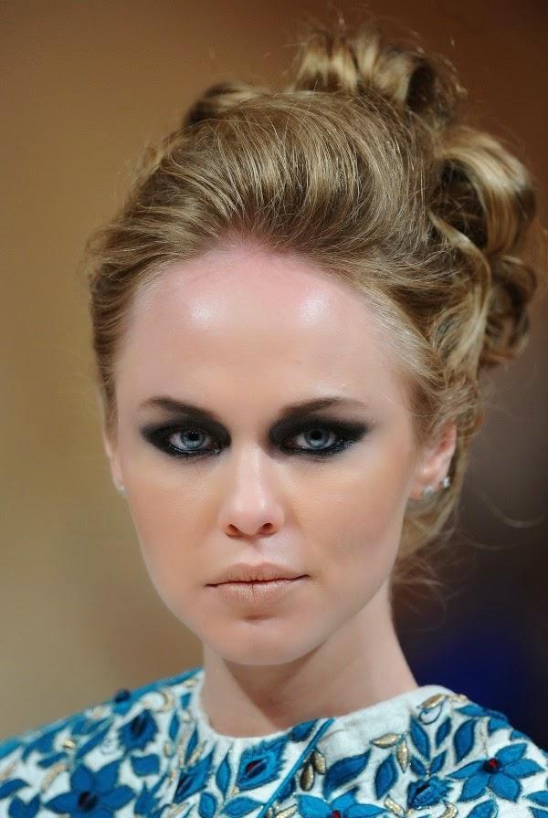 Models appear on the driveway dressed in dark, great smoky eye looks