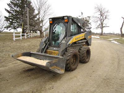 skidloader with cab, high moisture corn