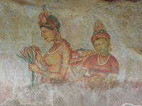 Ancient Lankan Lady with flowers and probably maidservant, dish of fruits, fresco in Sigiriya, graffiti, mystery