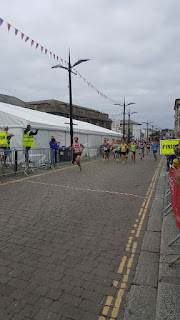 Runners passing the start line on the Truro Half Marathon