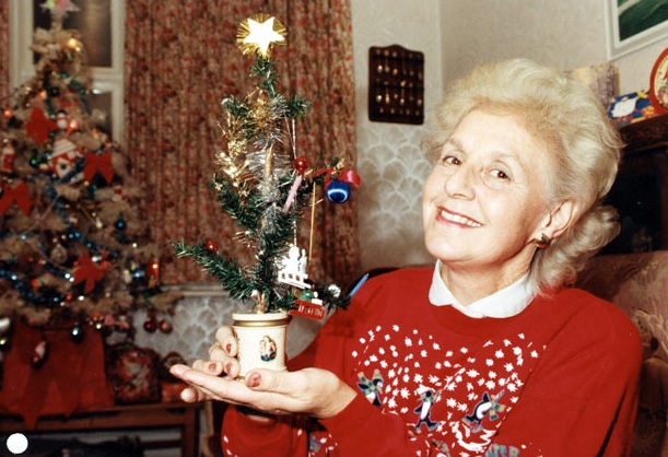 Every year, Janet Parker of Chippenham, Wiltshire, UK, puts up her Christmas tree, which was purchased - possibly from Woolworths - for her Great Aunt in 1886. Standing 30 cm (12 in) high in an ornate pot, it gets decorated with cherubs and the Virgin Mary.