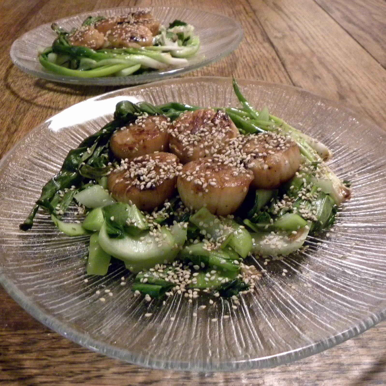 Scallops served with Sauteed Bok Choy and Grilled Scallions.