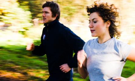9 Spring Date Ideas  - man and woman running sport park workout