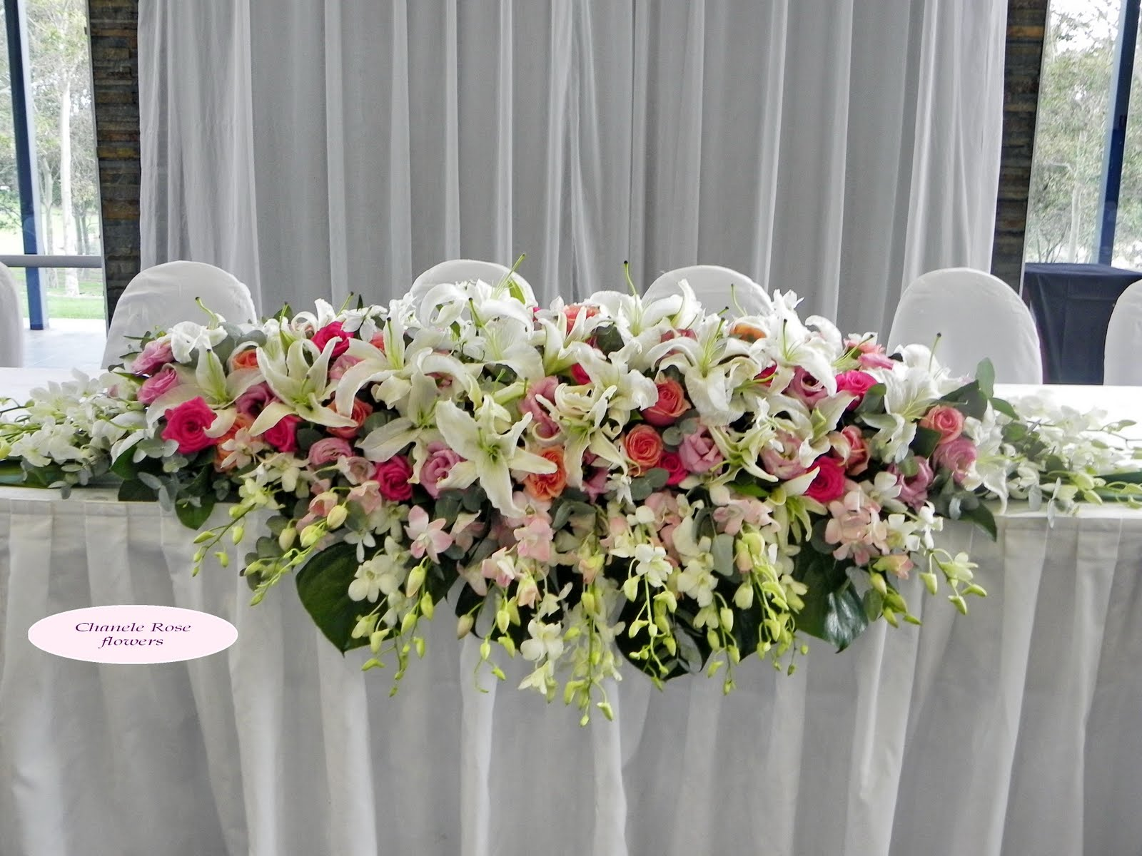 long and low bridal table flower arrangements
