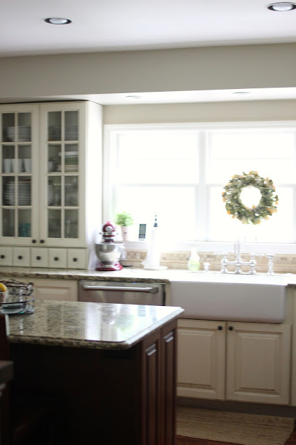 Shaw farm sink with wreath above sink and Behr Castle Path paint - www.goldenboysandme.com