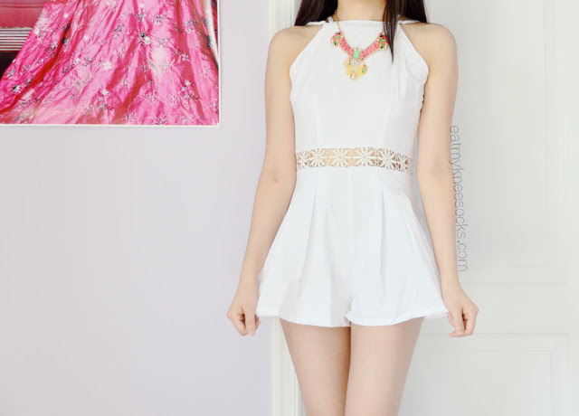 A cute summer OOTD: a white crochet-cutout romper, paired with a bright necklace from Bezel Box.