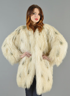 Vintage 1980's ivory colored Mongolian lamb shaggy fur coat with black dots.