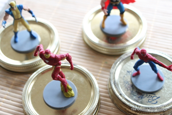 Make great super hero jar toy storage in minutes with this super simple tutorial.  Plus learn all about the new Super Buddies movie from Disney.