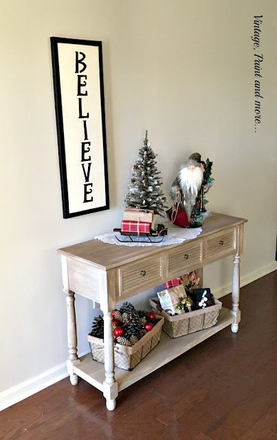 vintage Christmas vignette with old world Santa, wire baskets, pinecones, sled